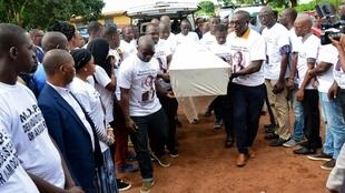 Family, friends, and colleagues accompany the coffin of Mamoudou Barry during a ceremony honouring his life at Sonfonia Public University, Conakry, Guinea.