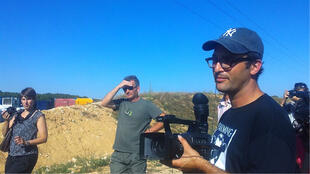 Gasland filmmaker Josh Fox next to the oil well in Jouarre