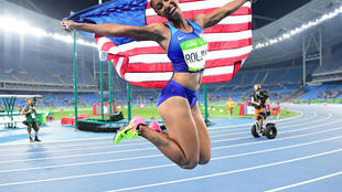 Brianna Rollins led a United States clean sweep of hte medals in the women's 100 meters hurdles.