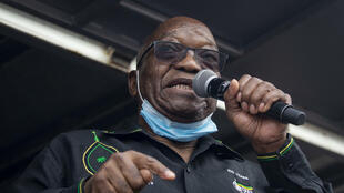 Zuma addressing his supporters camped outside his rural home on Sunday. He has mounted a last-ditch bid to head off a jail term for contempt of court