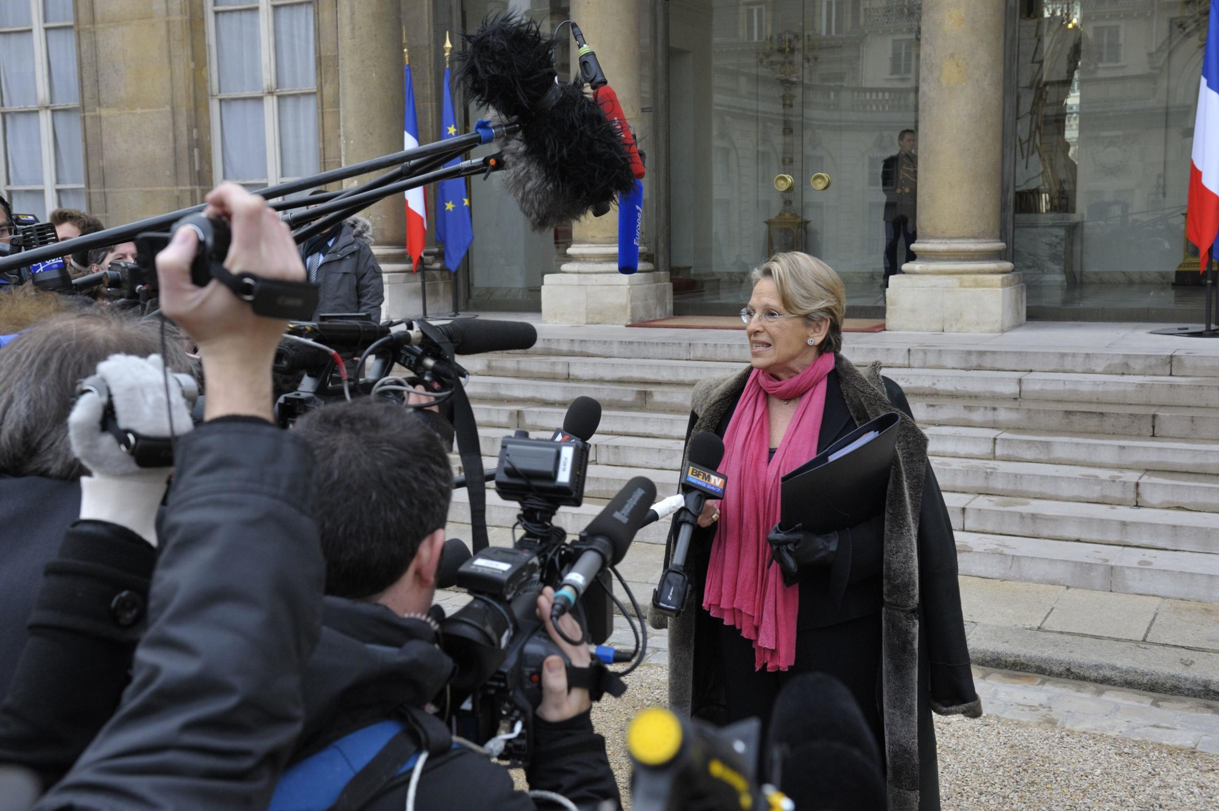 France's Foreign Affairs Minister Michele Alliot-Marie speaks to the media as she leaves the Elysee Palace 2 February 2011