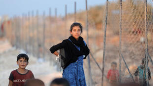 Trẻ em Syria chạy lánh nạn tại trại Atimah, trong tỉnh Idlib, ngày 11/09/2018.
