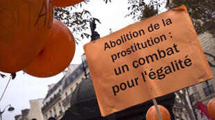 A placard calling for an end to abolition legislation for sex work at a demonstraion in Paris ahead of the Senate vote.