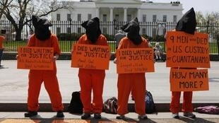 Activists rally in front of the White House demanding President Barack Obama to close down the US prison in Guantanamo Bay