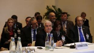 Waziri wa mashauri ya kigeni wa Syria, Walid Mouallem, katika mazungumzo ya kusaka amani mjini Geneva, le januari 22 mwaka 2014