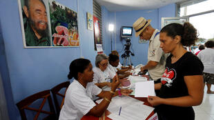 People register at a polling station to cast their votes during an election of candidates for the national and provincial assemblies, in Santa Clara, Cuba March 11, 2018.