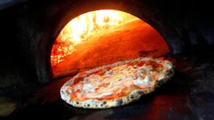 La traditionnelle «margherita», ici préparée à Naples.