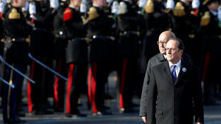 François Hollande and French Defense Minister Jean-Yves Le Drian stand before troops during the 11 November 2016 commemorations on the Champs-Elysées.