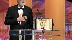 "Director Michael Haneke reacts after receiving the Palme d'Or award for the film ""Amour"""