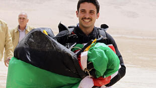 Jordanian Prince Hamzah bin Hussein shown in a file photo from April 17, 2012, carrying a parachute in the national colours in the country's Wadi Rum desert