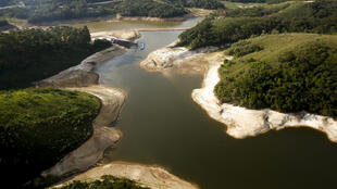 This file photo taken on December 17, 2014 shows an aerial view of the Atibainha river dam, in Nazare Paulista, during a drought affecting Sao Paulo state, Brazil