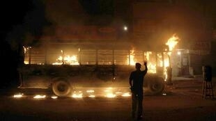 A bus burning in Karachi early Tuesday morning