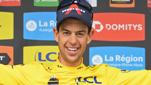 La joie de l'Australien Richie Porte, vainqueur du Critérium du Dauphiné, à l'issue de la 8e étape, disputée entre La Léchère-Les-Bains et Les Gets, le 6 juin 2021