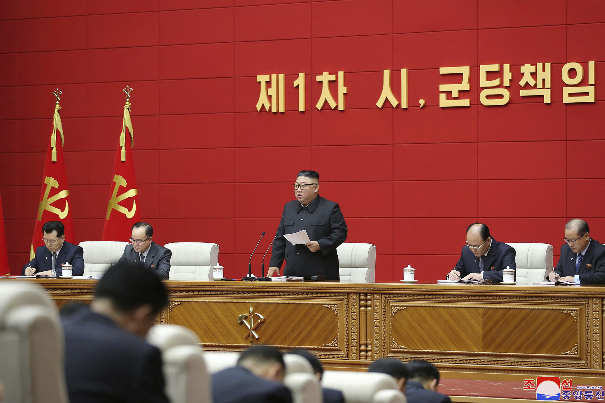 """In this photo provided by the North Korean government, North Korean leader Kim Jong Un, center, delivers a speech during a workshop of chief secretaries of city and county committees of the ruling Workers' Party in Pyongyang, North Korea, Wednesday, March 3, 2021. North Korea may be taking steps to extract plutonium to manufacture more nuclear weapons at its main atomic complex, recent satellite photos indicated, weeks after Kim vowed to expand his nuclear arsenal to cope with what he called U.S. hostility. Independent journalists were not given access to cover the event depicted in this image distributed by the North Korean government. The content of this image is as provided and cannot be independently verified. Korean language watermark on image as provided by source reads: """"KCNA"""" which is the abbreviation for Korean Central News Agency. (Korean Central News Agency/Korea News Service via AP)"""