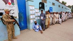 Men arrive to cast their votes outside a polling station in the presidential election in Jalalabad, Afghanistan