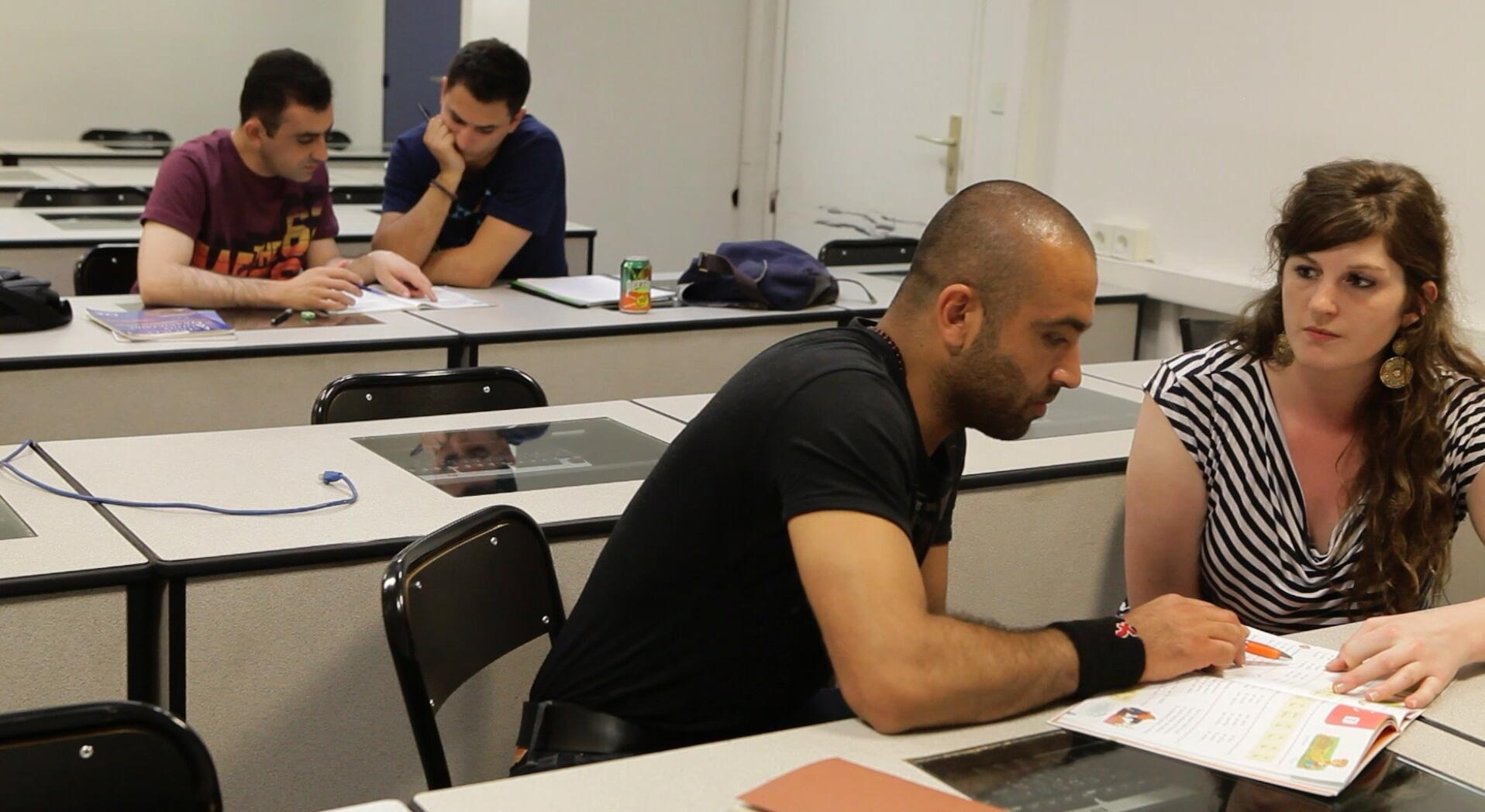 Migrants join educational programs to help them reach their goals in France