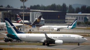Un Boeing 737 MAX8 de Silk Air sur le tarmac de l'aéroport Changi de Singapour, le 12 mars 2018.