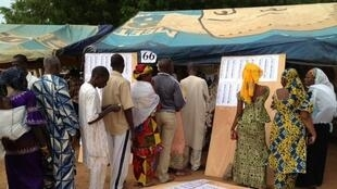 Malians line up to vote in front a polling station at a Bamako school.