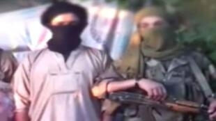 Video screenshot of two of the kidnappes of Hervé Gourdel.