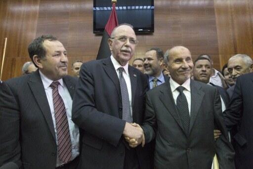 Libya's new interim prime minister Abdel Rahim al-Keib with predecessor Mahmud Jibril