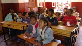 Street children attending maths class at the day centre of NGO Manda in Antananarivo