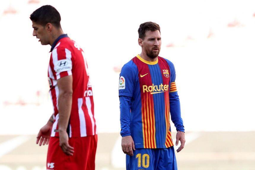Kaftin din Barcelona Lionel Messi tare da dan wasan Atletico Madrid Luis Suarez a yayin wasan da suka tashi 0-0 a gasar La Liga.