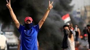 صحنه ای از تظاهرات جوانان معترض عراق