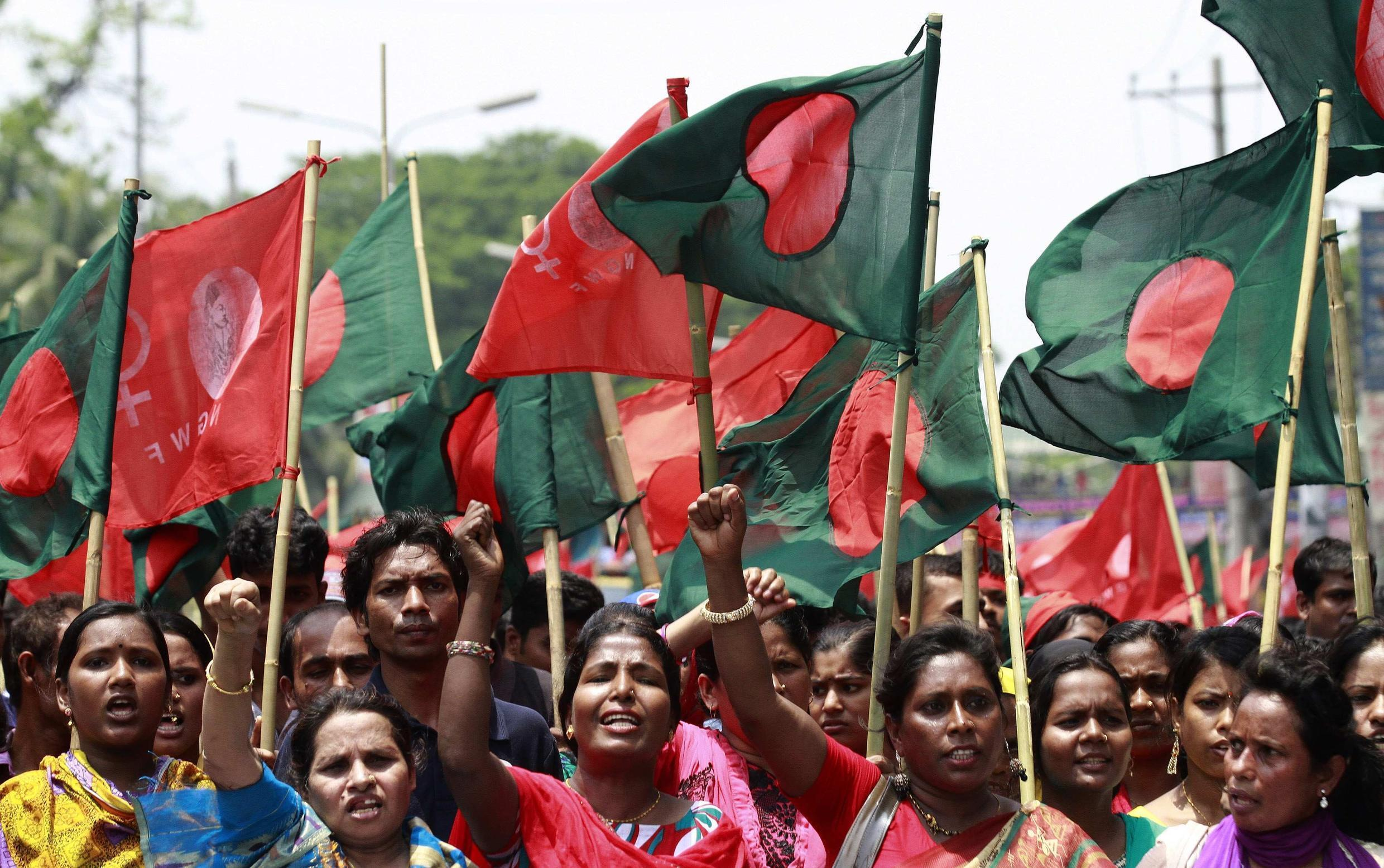 Bangladeshi textile workers demand compensation for victims of the Rana Plaza disaster on a May Day march in Dhaka