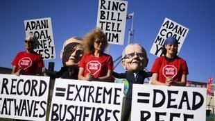 Protestors wearing puppet heads of Scott Morrison and Bill Shorten at a demonstration against coal mining.