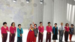South Korean choreographer Eun-Me Ahn with her troupe of dancers, after their performance at Théâtre de la Colline in Paris.