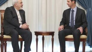 محمد جواد ظریف، وزیر امور خارجه ایران، در دیدار خود با بشار اسد رئیس جمهور سوریه