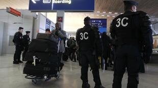 French police at terminal in Charles de Gaulle airport