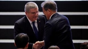 South Korean President Moon Jae-in shakes hand with IOC President Thomas Bach (L) during the 132nd IOC Session ahead of the 2018 Winter Olympic Games in Gangneung, South Korea, February 5, 2018.