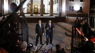 The representative of pro-Russian rebels in Donetsk, Denis Pushilin (R) in Minsk