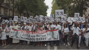 "Carrying signs saying ""stop racism"" and ""justice for doctor Mamoudou Barry"", hundreds of people marched in Paris Saturday to demand justice for the murdered Guinean researcher, 27 July 2019"
