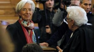Managing Director of the International Monetary Fund (IMF) Christine Lagarde (R) talks with her lawyer Bernard Grelon before the start of her trial about a state payout in 2008 to a French businessman, at the courts in Paris, France, December 12, 2016.
