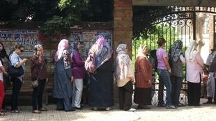 Women lining up outside El Sawra polling station in Dokki district of Cairo