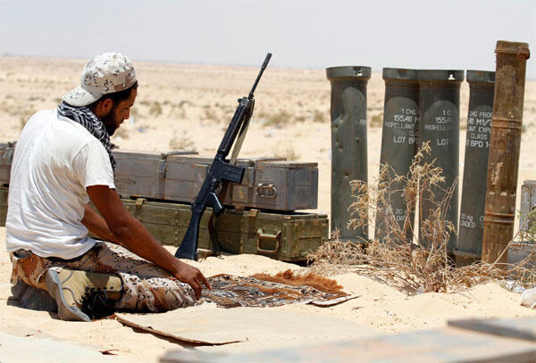 A rebel fighter prays on the frontline in Ajdabiyah earlier this month