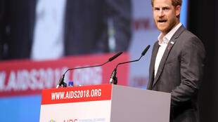 Britain's Prince Harry addresses a panel during the 22nd International AIDS