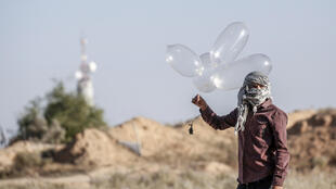 Palestinian militants have been using improvised balloons to carry incendiary materials across the Gaza border into Israel, which imposes a tight blockade on the enclave