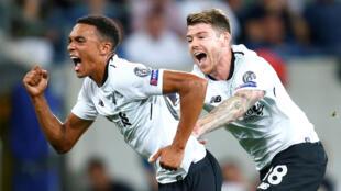 Liverpool's Trent Alexander-Arnold celebrates scoring the team's first goal