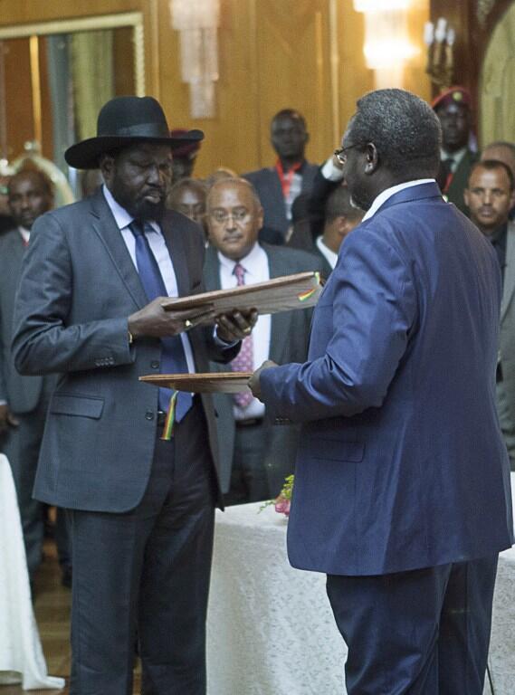 President Salva Kiir and Riek Machar exchange Cessation of Hostilities agreement on 9 May 2014 in Addis Ababa.
