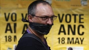 A demonstrator during a protest against the passing of new laws on state secrets