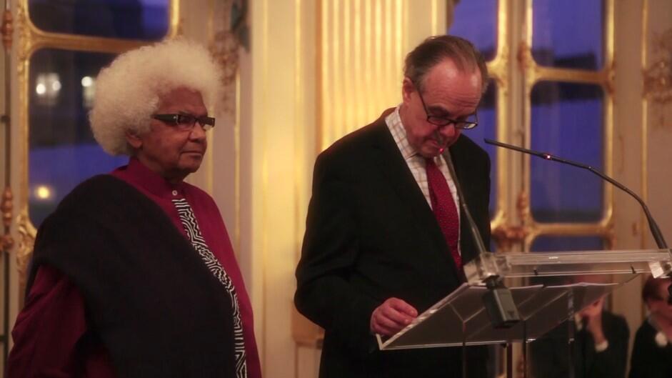 Screenshot video of Frederic Mitterand awarding filmmaker Sarah Maldoror a Chevalier de l'ordre national du Merite 2012