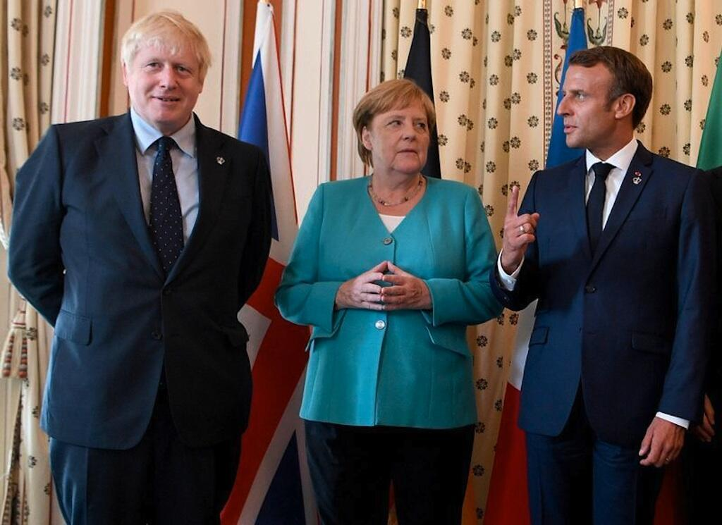Boris Johnson (L), Angela Merkel (C) and Emmanuel Macron (R) agreed to cooperate towards reducing tensions in the Middle East after an American drone killed Iranian General Qassem Soleimani in Iraq on Friday 3 January 2020.