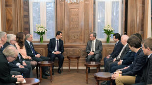 A handout picture released by the official Syrian Arab News Agency (SANA) on March 27, 2016 shows Syrian President Bashar al-Assad (c-L) meeting with a French delegation headed by French politician Thierry Mariani (C-R) in the capital Damascus.