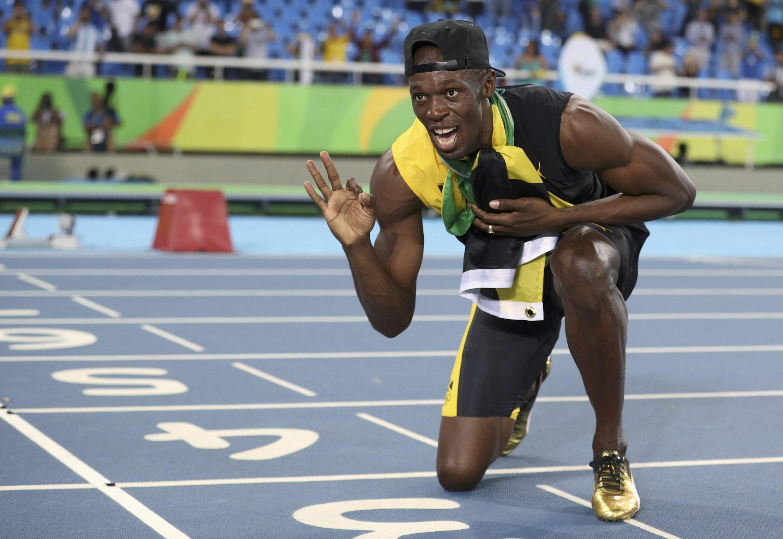 Usain Bolt poses with his third gold medal at Rio 2016.