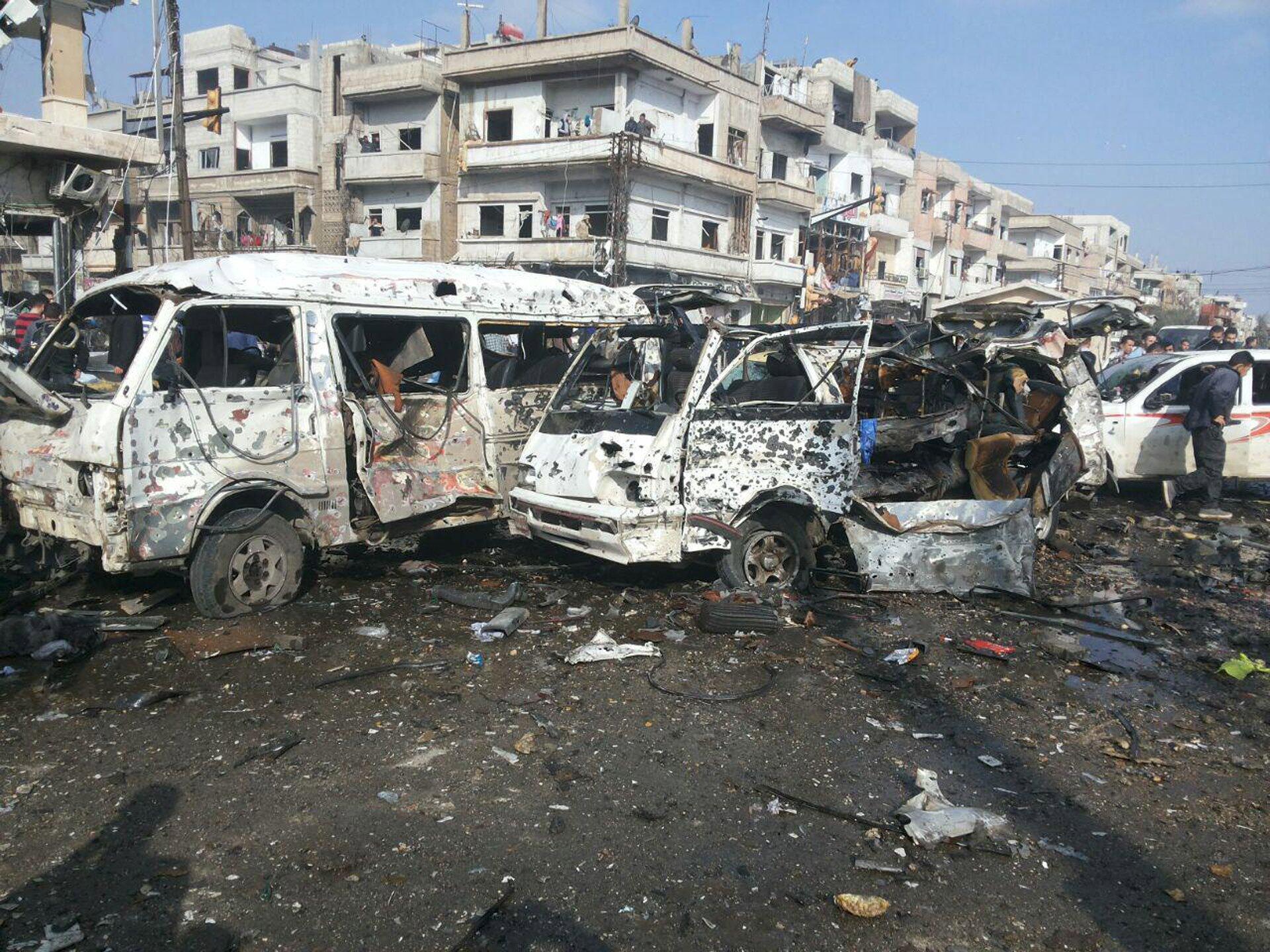 Hiện trường vụ tấn công khủng bố tại thành phố Homs, Syria, ngày 21/02/2016.