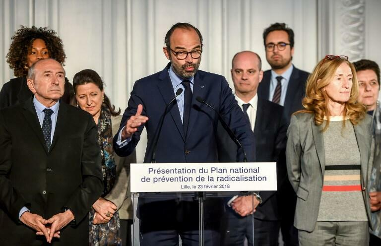 French Prime Minister Edouard Philippe (front row C) flanked by members of the government