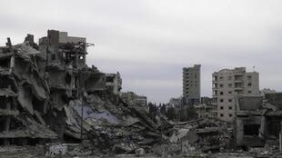 Damaged buildings in the besieged area of Homs